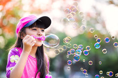 Blowing soap bubbles Stock Image