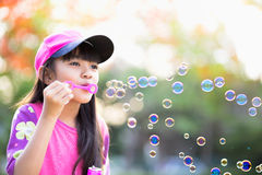 Blowing soap bubbles Royalty Free Stock Photo