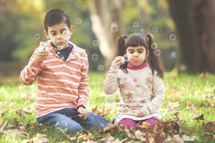 Blowing soap bubbles outdoors Stock Image