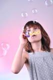 Blowing soap bubbles Stock Photos