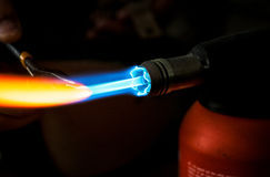 Blowing torch. Ultra hot, concentrated flame coming from a torch. Isolated on black background royalty free stock photos