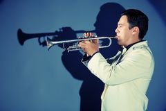 Blowing trumpet Stock Photos