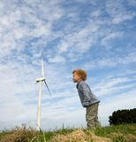 Blowing at a Turbine. Giant small child trying to get a turbine turning by blowing royalty free stock photos