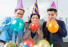 Blowing up balloons Stock Photos