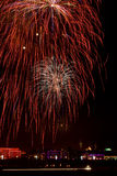Blowing up fireworks in the night sky Royalty Free Stock Photos