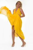 Blowing yellow dress Royalty Free Stock Images