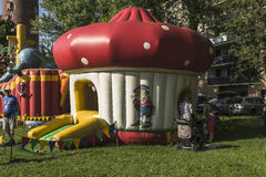 Blown building. Picnic and fun for children on the occasion of the Dragon Parade in Krakow, Poland Royalty Free Stock Images