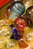 Blown glass. Details of a pile of blown glass spheres or decorative bulbs royalty free stock photos