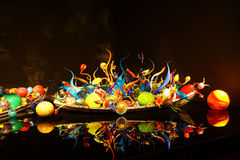 Blown glass spheres in boat Stock Photos