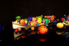Blown glass spheres in boat Royalty Free Stock Images