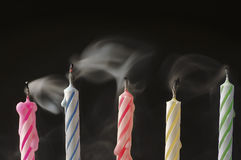 Blown out Birthday Candles. A line of birthday candles which have just been blown out.  Typically a chance to make a wish Royalty Free Stock Images