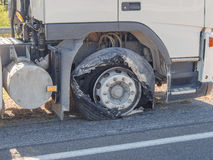 Blown truck front tire Royalty Free Stock Image