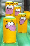 Blowned big bouncer toy with cartoon figures on top. Placed indoors Stock Photography
