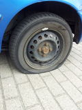 Blowout. Broken car tires Royalty Free Stock Photography