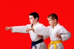 Blows arms in perform athletes  with blue and yellow belt Royalty Free Stock Photography