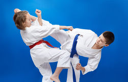 Blows and blocks in perfoming young athletes. Blows and blocks in perfoming young sportsmen Royalty Free Stock Photo