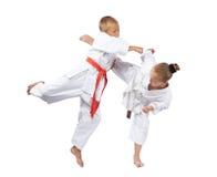 Blows karate athletes beat in karategi Royalty Free Stock Photography