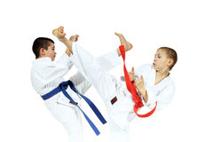 The blows Yoko geri and mae geri are performing sportsmens in karategi Stock Photography