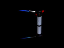 Blowtorch. A small hobby blowtorch on black surface with a reflection Royalty Free Stock Images
