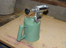 Blowtorch, general view. Blowtorch a with a green tank Stock Photography