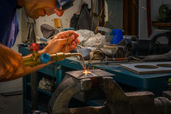 Blowtorch worker. A worker inside factory using blowtorch Royalty Free Stock Photos