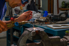 Blowtorch worker. A worker inside factory using blowtorch Royalty Free Stock Images