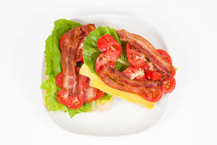 BLT on Homemade Bread. Top view of an open-face BLT with cheese on homemade bread Stock Photography