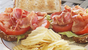 BLT open face sandwich on wheat with chips Stock Photo