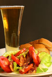 BLT Salad. Bacon, lettuce, tomato salad with toast and glass of beer Stock Photo