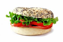 BLT sandwich on a bagel with turkey bacon over white Stock Images