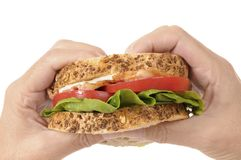 BLT sandwich by holding hands Royalty Free Stock Image