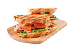 BLT sandwiches on wooden board Royalty Free Stock Photo