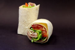 BLT Wrap. A delicious sandwich filled to the brim with delicious fillings - - YUM stock image