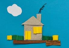 blått hus som göras över papper Royaltyfria Bilder