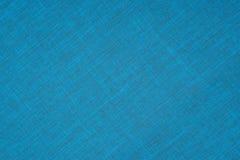 Blått torkdukebakgrundstyg Arkivfoto