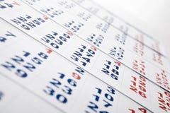 Blätter des Wandkalenders mit der Anzahl von Tagen Stockbild