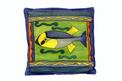 Blu cushion with fish. On green backgrounds Stock Photography