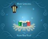 Blu della cartolina d'auguri del fondo di Natale Sui rami di abete Immagini Stock