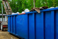 Blu dumpster, recycle waste recycling container trash on ecology and environment. Selective focus wasteyard reuse reduce industry construction industrial royalty free stock images