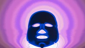 Blu glowing mask on bright abstract background stock image