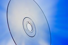 Blu-Ray Disc Concept. Disc closeup with blue background Royalty Free Stock Image