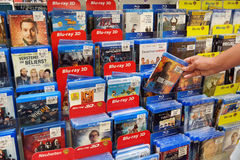 Blu-ray Discs and DVDs. GERMANY - JULY 2015: Customer select a dvd in a media aisle of a Real hypermarket Stock Photos