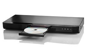 Blu-ray DVD 3. Blue Ray player with a disk on a white background closeup Royalty Free Stock Images