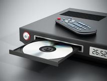 Blu-ray player with open disc tray. And remote controller Stock Photos