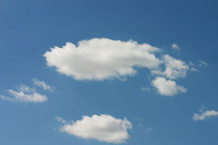 Blu sky with clouds. White clouds floating in the clean sky in september Royalty Free Stock Images