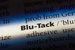 Blu-tack. Word in a dictionary.  concept stock images