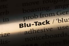 Blu-tack. Word in a dictionary.  concept royalty free stock photos
