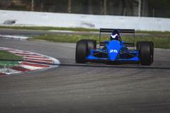 Blu vintage racing car. An old ligier racing car running in the circuit of Monza, Italy stock photography