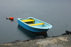 Blu and yellow boat on the lake. A coloured boat on the lake Stock Image
