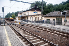 Bludov railway station in Czech republic. Bludov railway station with track, platform, buiilding and train near Sumperk city in Czech republic stock photography